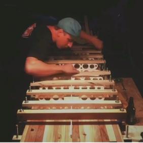 Gluing skeleton to redwood base.