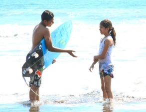 Like father like son. Juan's boy teaching his younger sister to surf.